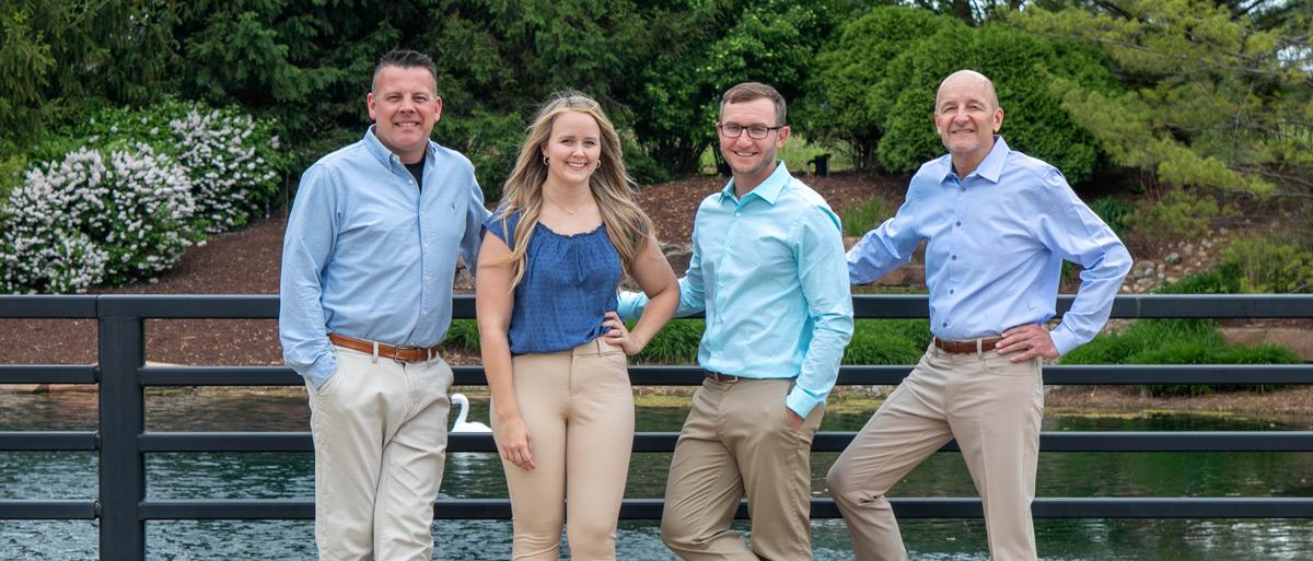 Collins Dental Group doctors posing on bridge