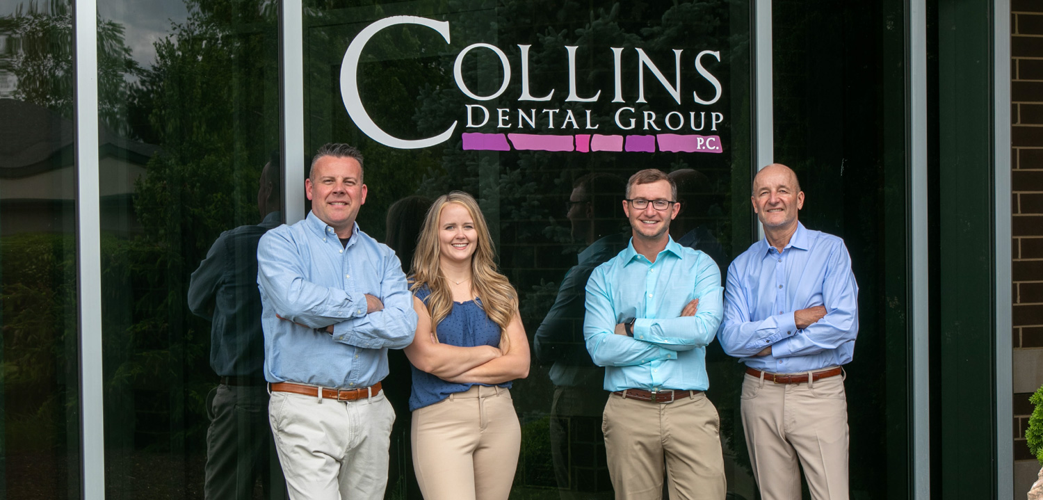 Collins Dental Group doctors posing in front of building